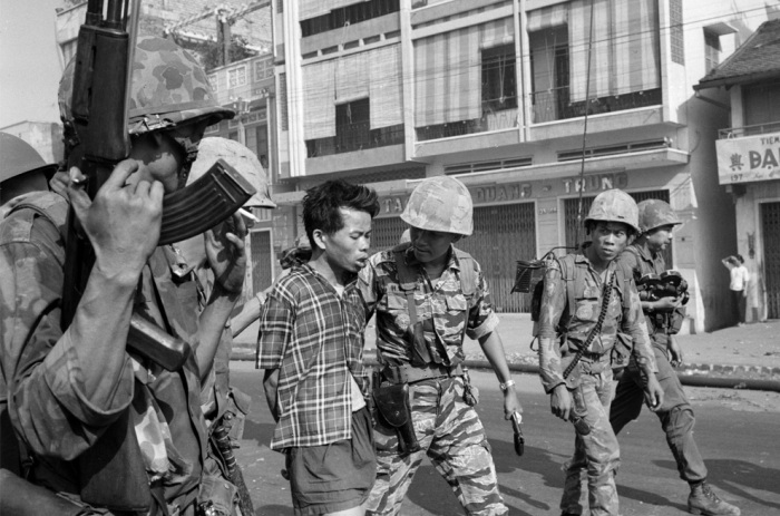 (1 of 3) South Vietnamese forces escort suspected Viet Cong officer Nguyen Van Lem (also known as Bay Lop) on a Saigon street Feb. 1, 1968, early in the Tet Offensive. (AP Photo/Eddie Adams)