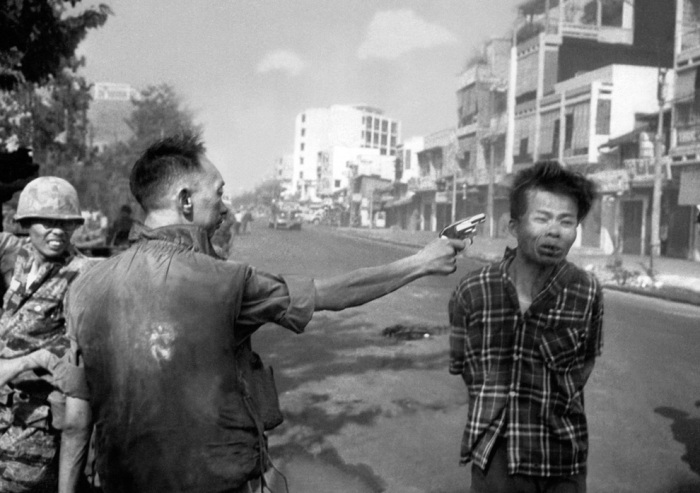 (2 of 3) South Vietnamese General Nguyen Ngoc Loan, chief of the national police, fires his pistol into the head of suspected Viet Cong officer Nguyen Van Lem on a Saigon street, on Feb. 1, 1968. (AP Photo/Eddie Adams)