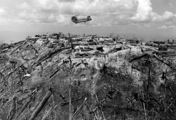 A supply helicopter comes in for a landing on a hilltop forming part of Fire Support Base 29, west of Dak To in South Vietnam's central highlands on June 3, 1968. Around the fire base are burnt out trees caused by heavy air strikes from fighting between North Vietnamese and American troops. (AP Photo)