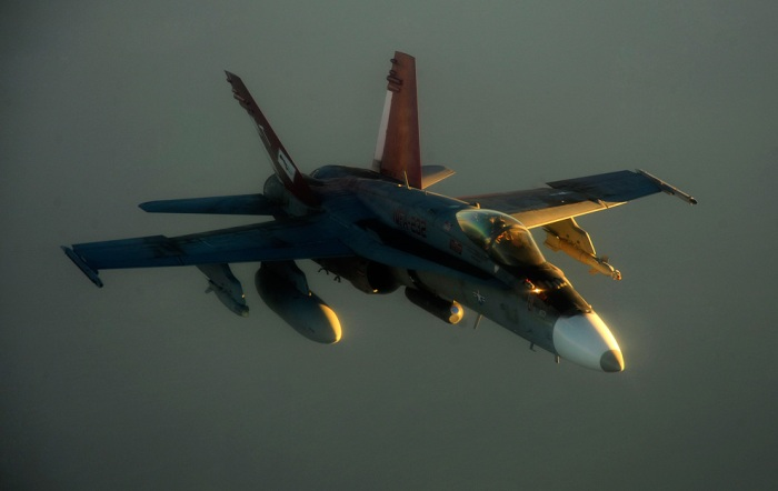 A U.S. Marine Corps F-18 Hornet aircraft prepares to refuel over Afghanistan July 8, 2010. (U.S. Air Force photo by Staff Sgt. Andy M. Kin/Released)