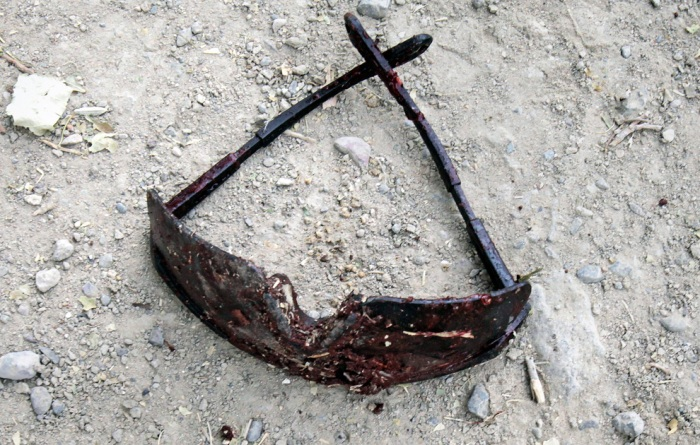 A pair of bloody sunglasses lie on the ground after an IED exploded injuring two US Army soldiers just outside Combat Outpost Nolen in the Arghandab Valley north of Kandahar July 30, 2010. (REUTERS/Bob Strong)